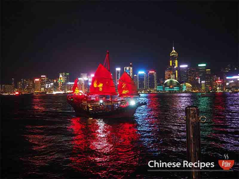 hong kong skyline tsim tsa tsui junk boat