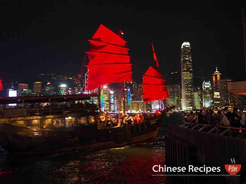 hong kong skyline tsim tsa tsui junk boat up close